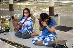 Asian Thai Women Mother And Daughter Sit And Respect Praying Buddha Statue At Wat Phra That Doi Tung In Chiang Rai, Thailand Stock Photos