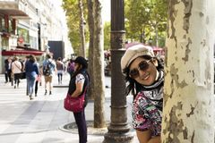 Asian thai women playful and travel visit at sidewalk in L'avenue des Champs-Elysees. On September 6, 2017 in Paris, France royalty free stock images
