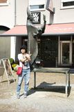 Asian thai women traveler posing with bronze statue for take photo. At Marktplatz or market place of Ladenburg on August 28, 2017 in Baden-wurttemberg, Germany Stock Photography