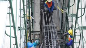 Asian thai worker and heavy machinery working builder new building at a construction site stock video