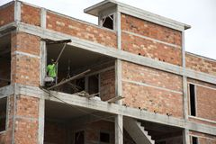 Asian thai workers and local machinery working builder new building Royalty Free Stock Image
