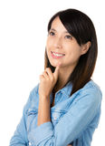 Asian thoughtful woman looking up Stock Photo