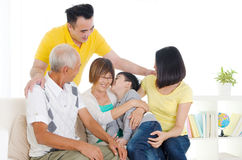Asian three generations family. At home. Grandson kissing Grandmother Royalty Free Stock Photography