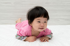 Asian toddler on bed Royalty Free Stock Photo