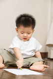 Asian toddler busy drawing Royalty Free Stock Photo