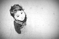 Asian toddler looking upwards. Black and white elevated view of Asian male toddler looking upwards Stock Photos