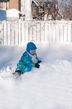 Asian toddler playing with snow Stock Image