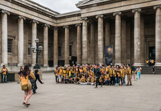 Asian tour group poses for photograph outside British Museum Royalty Free Stock Image