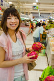 Asian tourism is choosing Pitaya fruit in Thailand open market Royalty Free Stock Photo
