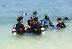 Asian Tourist Group learning how to snorkel Stock Photo