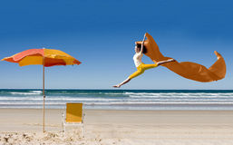 Asian tourist jumping at beach Royalty Free Stock Photos