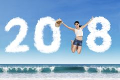 Asian tourist jumping with numbers 2018 Stock Photos