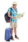Asian tourist man. Attractive Asian tourist man looking at map Royalty Free Stock Photos