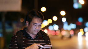 Asian tourist Man taking photo with camera phone at street night stock video