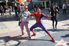 Asian tourist poses with Spiderman Stock Image