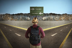 Asian tourist standing in the middle of crossroad Royalty Free Stock Images
