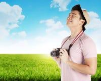 Asian tourist take photo on green meadow Stock Image