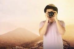 Asian tourist take photo on mountain Royalty Free Stock Image