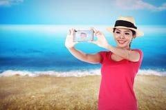 Asian tourist take selfie on the beach Stock Photos
