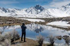 Free Asian Tourist Taking Photo Of Mammoth Mountain Royalty Free Stock Photo - 147624115