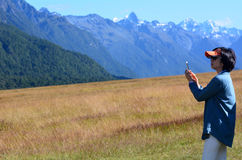 Asian tourist visit in Fiordland Royalty Free Stock Images