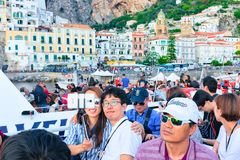 Asian tourists aboard making selfie with Amalfi town Tyrrhenian sea stock image