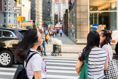 Asian tourists crossing the road, NYC stock photos