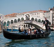 Asian tourists enjoy gondola trip, Venice, Italy Royalty Free Stock Images