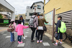 Asian tourists family looking at direction map. KYOTO, JAPAN, OCTOBER 09,2016 : Asian tourists family looking at direction map board in Kyoto, Japan Stock Images