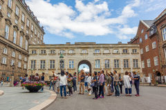 Asian tourists in front of danish parliament. Tourists on Guided tour in Copenhagen Stock Images