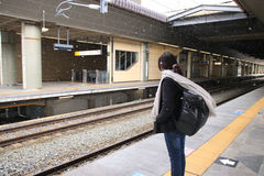 Asian tourists girls waiting train Royalty Free Stock Photography