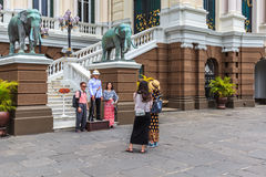 Asian tourists in the Grand Palace, Bangkok, Thailand. Stock Images