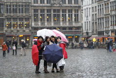 Asian tourists posing at Grand Place Royalty Free Stock Photos