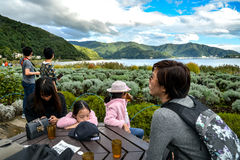 Asian tourists relaxing at avender farm in Oishi Stock Image