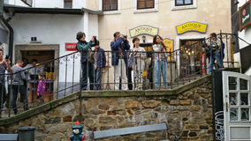 Asian tourists shoot Krumlov Royalty Free Stock Image