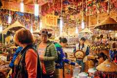 Asian tourists shopping at gift store in the Old Town of Lijiang Stock Photography