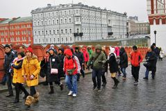 Asian tourists visit Moscow Kremlin.