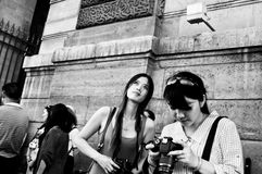 Asian tourists wake at Rivoli street in Paris Stock Images