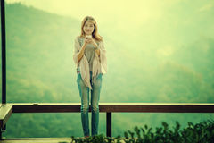 Asian tourists woman on balcony at Tea garden doi angkhang Thail Royalty Free Stock Photography