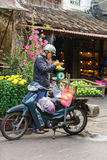 Asian trader with a motor bicycle selling fresh chayote Stock Photo