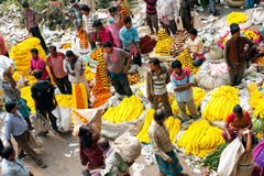 Asian traders sell the flowers on the Market Stock Photo