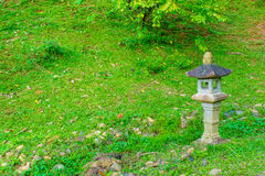 Asian traditional lamp in a garden with lush lawn. Park Prenn, Dalat city Vietnam Royalty Free Stock Photos