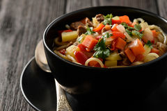 Asian traditional soup with noodles, meat and vegetables known as lagman. Stock Photos