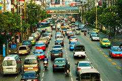 Asian traffic. The big automobile stopper on one of the central streets of Bangkok Royalty Free Stock Photography