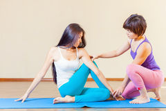 Asian trainer conducts classes of group yoga indoor. At yoga class. Concept of a healthy lifestyle and the right attitude to life royalty free stock photo