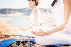 Asian trainer conducts classes of group yoga outdoor. At mountain. Concept of a healthy lifestyle and the right attitude to life. China Stock Photos