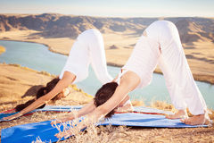 Asian trainer conducts classes of group yoga outdoor. At mountain. Concept of a healthy lifestyle and the right attitude to life. China Royalty Free Stock Images