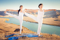 Asian trainer conducts classes of group yoga outdoor. At mountain. Concept of a healthy lifestyle and the right attitude to life. Kazakhstan, Almaty Stock Photography