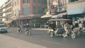 Asian transport traffic on the central waterfront street with cars, motorbikes, tuk-tuks. stock video