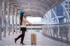 Asian Travel woman wearing sweater coat, blue yarn hat and hold Royalty Free Stock Image